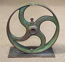 Mounted cast iron industrial wheel painted green