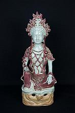 A Chinese Copper Red and Celadon Glazed Figure of Guanyin
