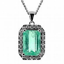 An Emerald and Diamond Pendant