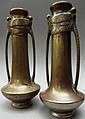 A pair of bronze campana form vases with twin