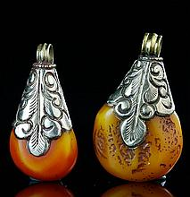 A PAIR OF SILVER MOUNTED BEESWAX PENDANTS