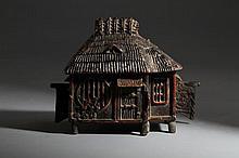 A HOUSE-FORM BRONZE CENSER