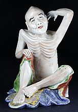 A LATE QING FAMILLE ROSE LOHAN STATUE