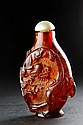 AN AMBER CARVED DRAGON SNUFF BOTTLE
