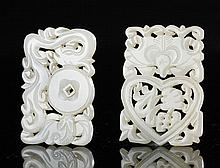 A PAIR OF WHITE JADE OPENWORK PENDANTS