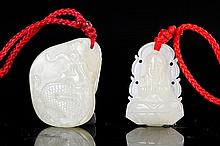 TWO SMALL PALE GREENISH-WHITE JADE PENDANTS