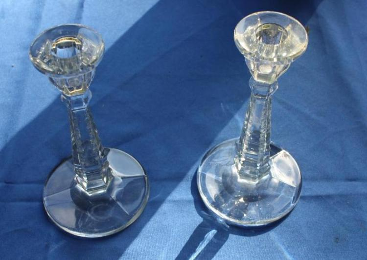 Set of etched glass candle holders.