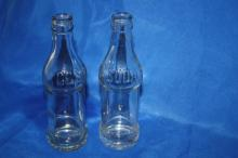 2 CC Soda Bottles