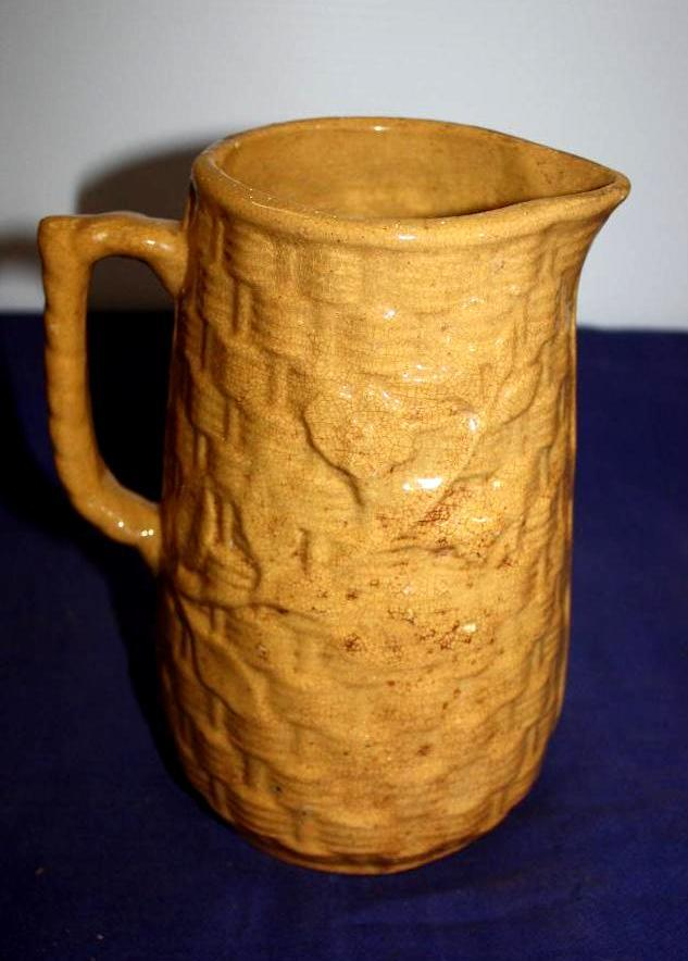 Stoneware weaved pitcher