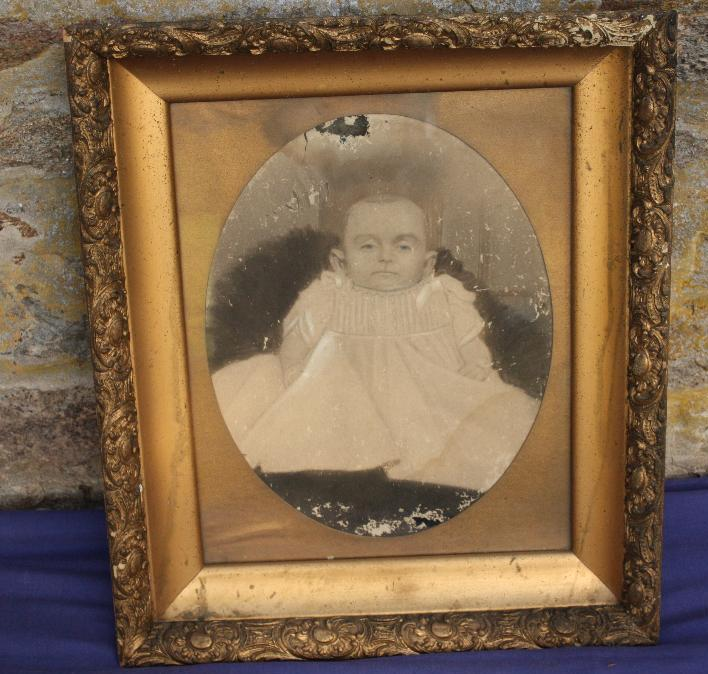 Framed photo of baby.