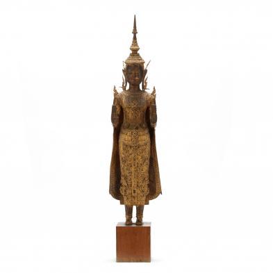 A Thai Gilt Bronze Standing Buddha Sculpture
