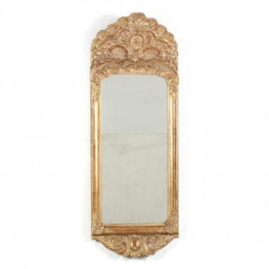 A Highly Carved and Gilded French Wall Mirror