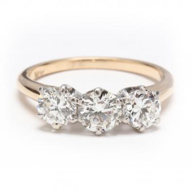 14KT Gold, Platinum, and Three Stone Diamond Ring