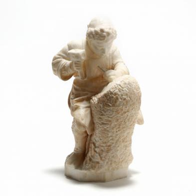 A Carved Alabaster Sculpture of a Sculptor