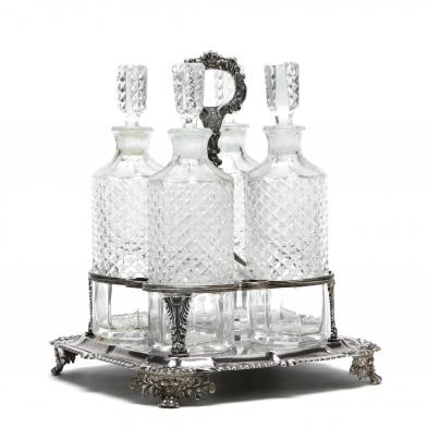 A George IV Silver Four Bottle Decanter Stand