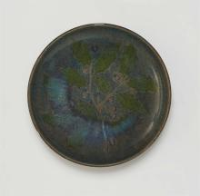 An earthenware dish with holly decor
