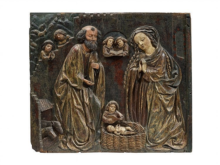 A carved wooden relief of the nativity probably bavarian e