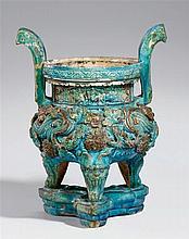 A large turquoise and aubergine-glazed tripod incense burner. Ming dynasty (1368-1644)