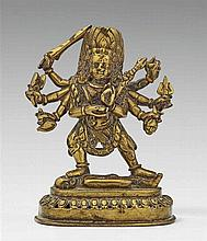 A Nepalese brass figure of an eight-armed Mahakala. 19th century
