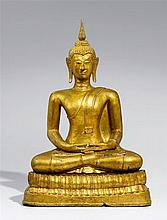 A Thai gilded and lacquered bronze figure of Buddha. 19th century or earlier