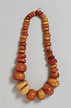 A Tibetan necklace with 46 beads of amber and other resins
