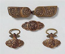 Three Tibetan gold damascened iron belt ornaments. 17th/18th centuryAnd Tibetan brass belt-buckle