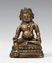 A Tibetan bronze figure of Jambhala. Pala style, 13th century