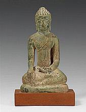 A Thai Dvaravati-style bronze figure of Buddha Shakyamuni. 7th/8th century