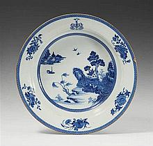 A large blue and white armorial basin. Qianlong period (1735-1796)