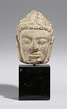 A Champa stone cast head of a Buddha. Probably 10th century
