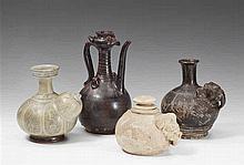 Four stoneware vessels. 13th-15th century