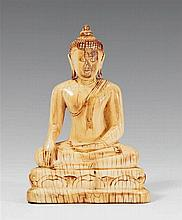 A Northern Thai ivory Buddha in maravijaya.19th century