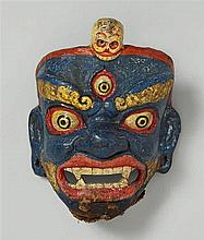 A Tibetan polychromed papier-maché mask of a dharmapala. 19th century