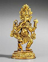A Tibetan or Nepalese gilt bronze figure of Ganapati. Possibly 19th century