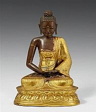 A Tibetan partly gilt copper repoussé figure of Buddha Shakyamuni. 18th/19th century