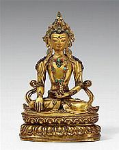 A superb Tibetan gilt bronze figure of Buddha Akshobhya. 17th century