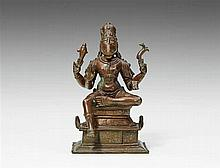 A South Indian copper alloy figure of Nandikeshvara, the anthropomorphic form of Nandi and attendant of Shiva. 18th century