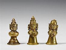 Three Maharashtra brass figural finials used for a Yellamma basket. 19th century