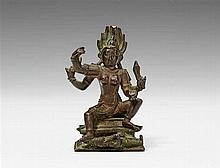 A South Indian Tamil Nadu copper alloy figure of a four-armed Kali. 16th century