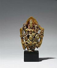 A Kashmiri bronze group of the eight-armed Vasudeva-Kamalaja seated on Garuda. 12th century