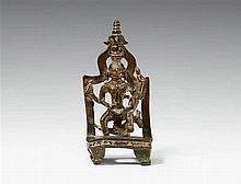 A Gujarati/Rajasthani copper alloy shrine of jaina yakshi Nirvani. Dated 1593