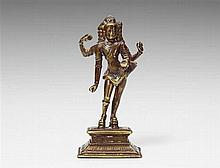 A South Indian copper alloy figure of Shiva Bhikshatana. Tamil Nadu. 16th/17th century
