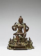 A South Indian Tamil Nadu copper alloy figure of Shiva as Lord of Gnosis (Vakyana Dakshinamurti). 16th century