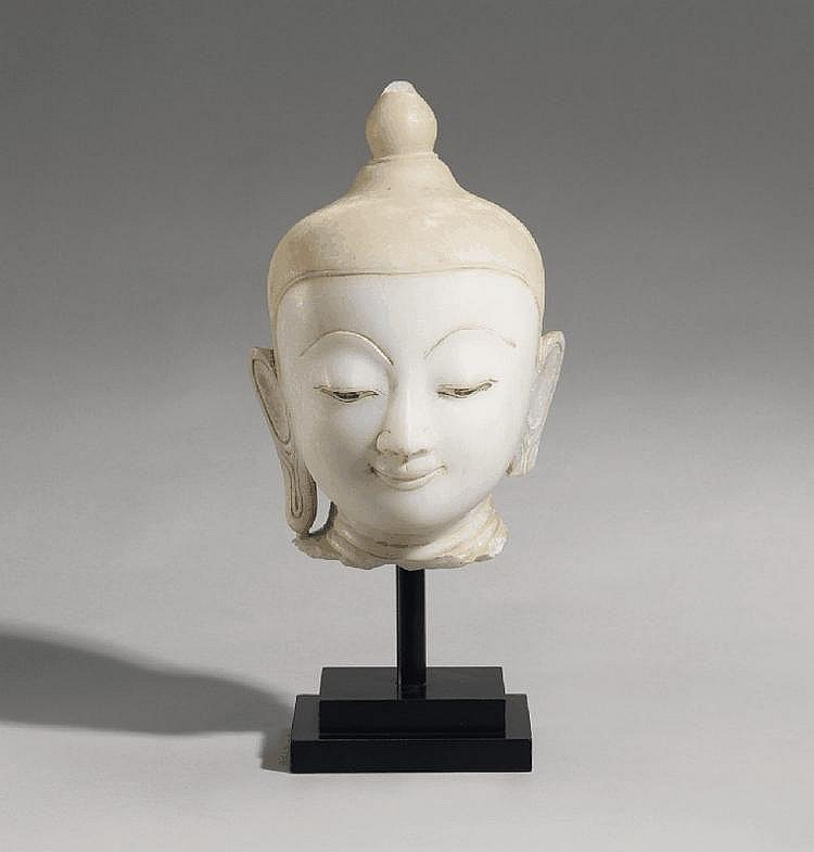 An alabaster head of a Buddha. Burma. 19th/20th century