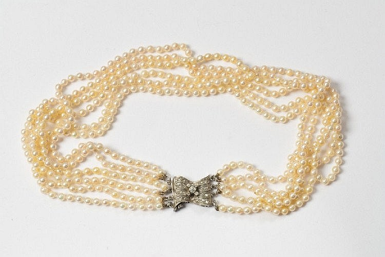 A platinum, diamond and pearl necklace