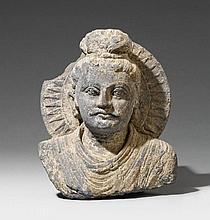 A Gandhara grey schist bust of a Buddha. 2nd/3rd century