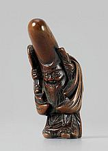 A large boxwood netsuke of a laughing Fukurokuju, by Shukô. Early 19th century