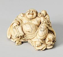 A large ivory netsuke of a laughing Hotei. 18th/early 19th century