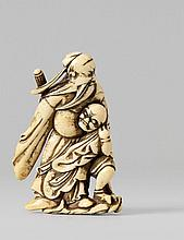 A large and unusual ivory netsuke of Shôki with a captured oni. 18th century