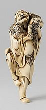 A large ivory netsuke of a tall sennin with a shishi. Late 18th century